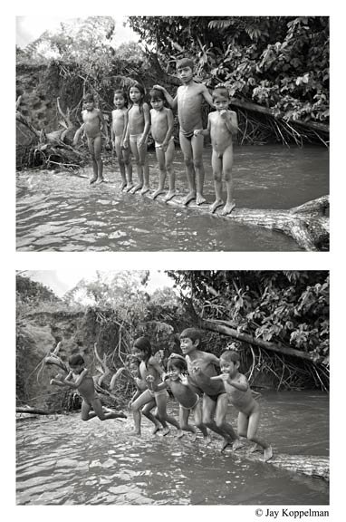 Shuar indian children playing in a river in the Amazon Jungle close to Macas, Ecuador.