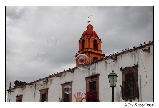 Kid catching bubbles in San Miguel de Allende, Guanajuato, Mexico.