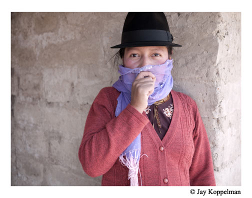 Young indigenous woman in the cold in Quilotoa, Ecuador.