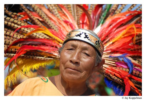 A native indian with head dress in San Miguel de Allende, Mexico.