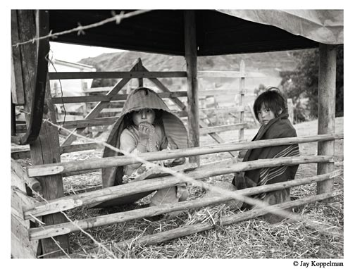 Quechua indigenous children find shelter from the cold in the Andes Mountains of Zumbahua, Ecuador.