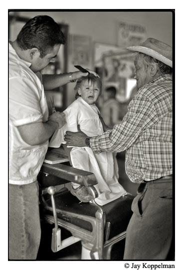 A child gets his first hair cut in Ajijic, Mexico.