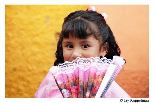 Little Mexican girl and fan in San Miguel de Allende, Mexico.