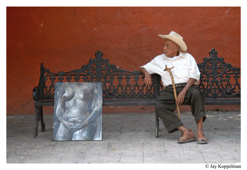 Old man sits next to a nude painting in Ajijic, Mexico, by Jay Koppelman.
