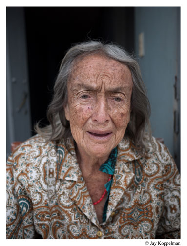 Elderly woman in Popayan, Colombia with wrinkled face.