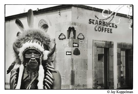 An Mexican indian walks past Starbucks Coffee in San Miguel de Allende, Guanajuato, Mexico.